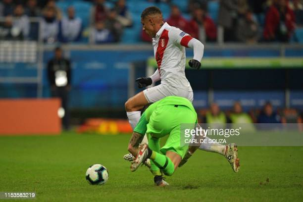 Peru's Paolo Guerrero eludes Chile's goalkeeper Gabriel Arias to score the team's third goal during their Copa America football tournament semifinal...
