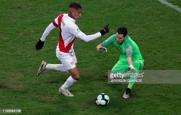 TOPSHOT Peru's Paolo Guerrero eludes Chile's goalkeeper Gabriel Arias to score the team's thrid goal during their Copa America football tournament...