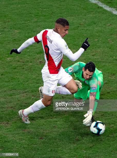 Peru's Paolo Guerrero eludes Chile's goalkeeper Gabriel Arias to score the team's thrid goal during their Copa America football tournament semifinal...