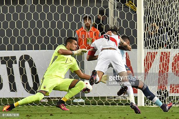 Peru's Paolo Guerrero scores against Argentina's goalkeeper Sergio Romero during their Russia 2018 World Cup qualifier football match in Lima on...