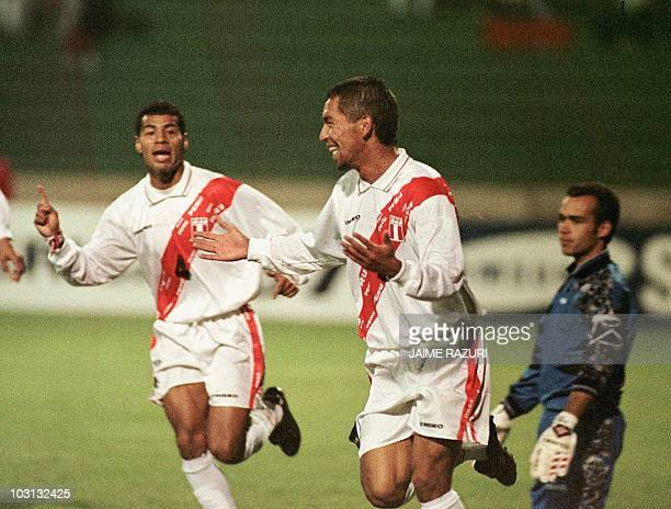 Peru's Paul Cominges celebrates his first goal against Venezuela 18 June in Sucre Bolivia during their Copa America match Cominges scored the two...