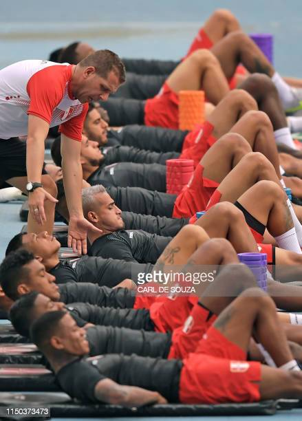 Peru's players take part in a training session in Rio de Janeiro Brazil on June 17 on the eve of their Copa America football tournament match against...