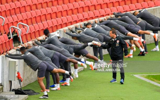 Peru's players train during a practice session in Porto Alegre , Brazil, on July 1 ahead of the Copa America tournament football match between Chile...
