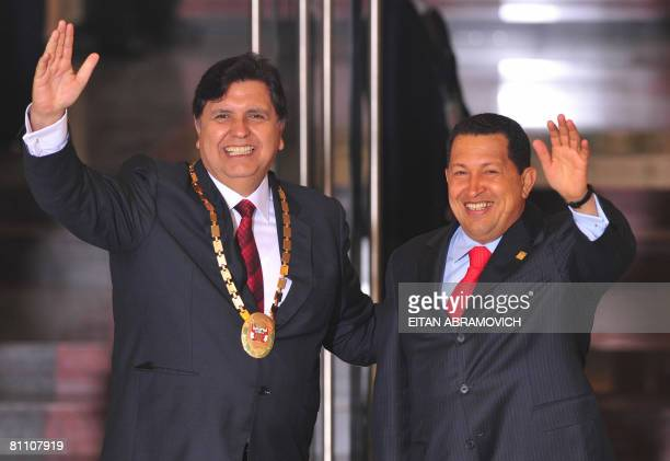 Peru's President Alan Garcia and Venezuela's President Hugo Chavez wave before the plenary session of the V Summit of Heads of State and Government...