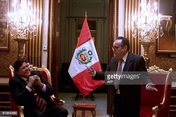 Peru's President Alan Garcia chats with Mexican actor Roberto Gomez Bolanos el popular actor televisivo Chavo del Ocho during a meeting at the...