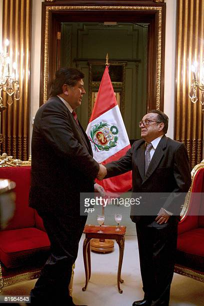 Peru's President Alan Garcia shakes hands with Mexican actor Roberto Gomez Bolanos the popular televison character Chavo del Ocho during a meeting at...