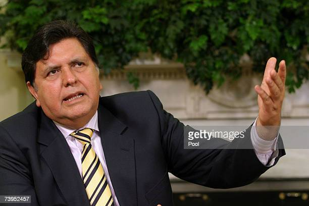 Peru's President Alan Garcia speaks during his meeting with US President George W Bush in the Oval Office at the White House April 23 2007 in...