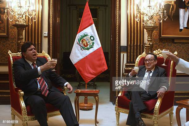 Peru's President Alan Garcia toasts with Mexican actor Roberto Gomez Bolanos the popular televison character Chavo del Ocho during a meeting at the...