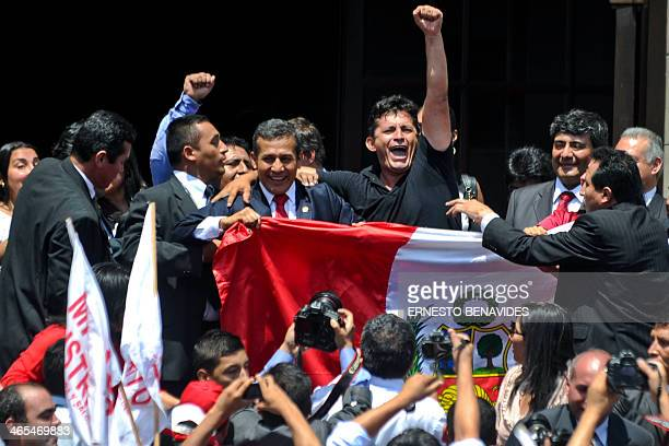 Peru's President Ollanta Humala celebrates with the crowd gathered outside the presidential palace in Lima after a World Court ruling favored Lima in...