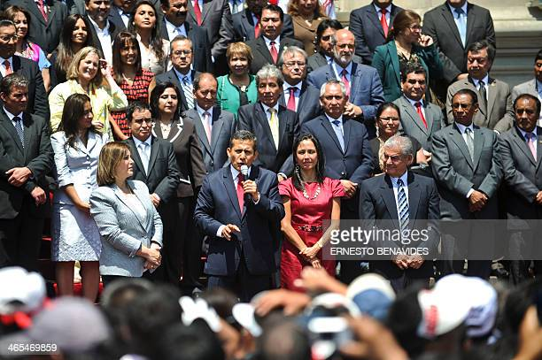 Peru's President Ollanta Humala delivers a speech to the crowd gathered outside the presidential palace in Lima next to his wife Nadine Heredia after...