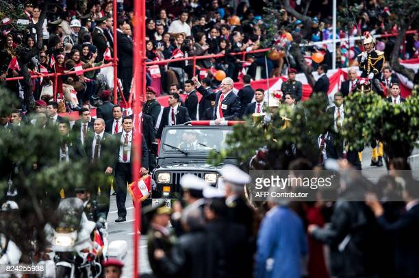 Perus President Pedro Pablo Kuczynski waves upon arrival to attend a military parade within celebrations for Peru's Independence Day in Lima on July...