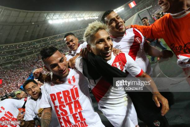 Peru's Raul Ruidiaz and his teammate Miguel Trauco celebrate after defeating New Zealand by 20 and qualifying for the 2018 football World Cup in Lima...