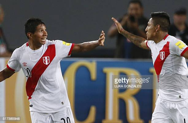 Peru's Raul Ruidiaz celebrates with teammate Edison Flores after scoring against Venezuela during their Russia 2018 FIFA World Cup South American...