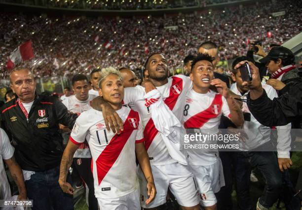 TOPSHOT Peru's Raul Ruidiaz Jefferson Farfan and Christian Cueva celebrate after defeating New Zealand by 20 and qualifying for the 2018 football...