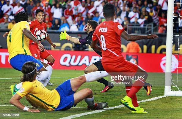 Peru's Raul Ruidiaz takes a pass from teammate Andy Polo and beats a lunging Brazil goal keeper Alisson for the only goal of the game late in the...