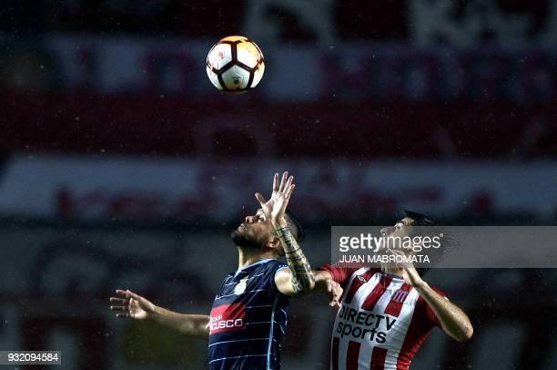 Peru's Real Garcilaso midfielder Luis Garcia vies for the ball with Argentina's Estudiantes de La Plata forward midfielder Rodrigo Brana during their...