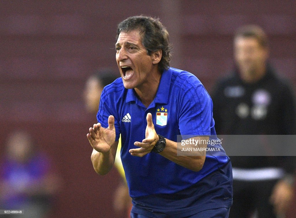 Peru's Sporting Cristal coach Mario Salas gestures during their Copa Sudamericana 2018 first stage football match against Argentina's Lanus at 'La Fortaleza' stadium in Lanus, Buenos Aires, Argentina, on February 21, 2018. /