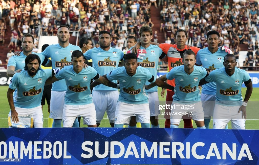 Peru's Sporting Cristal football team pose during the Copa Sudamericana 2018 first stage football match against Argentina's Lanus at 'La Fortaleza' stadium in Lanus, Buenos Aires, Argentina, on Feb...
