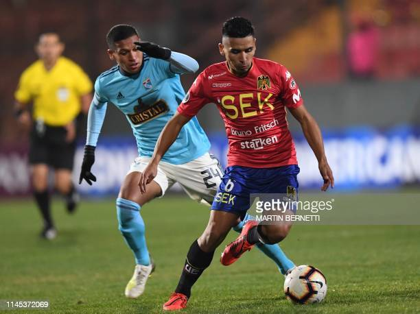 Peru's Sporting Cristal footballer Fernando Pacheco marks Chile's Union Espanola Luis Pavez during their Copa Sudamericana football match at the...