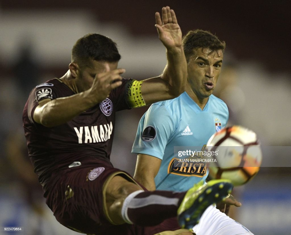 Peru's Sporting Cristal forward Gabriel Costa (L) vies for the ball with Argentina's Lanus midfielder Ivan Marcone during their Copa Sudamericana 2018 first stage football match at 'La Fortaleza' s...