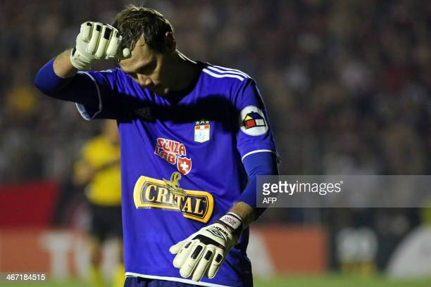Peru's Sporting Cristal goalie, Diego Penny looks disappointed after the defeat against Brazil's Atletico Paranaense during their Libertadores Cup...