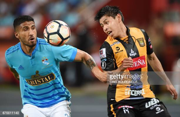 Peru's Sporting Cristal player Josepmir Ballon vies for the ball with Bolivias Strongest player Agustin Jara during their Copa Libertadores match at...