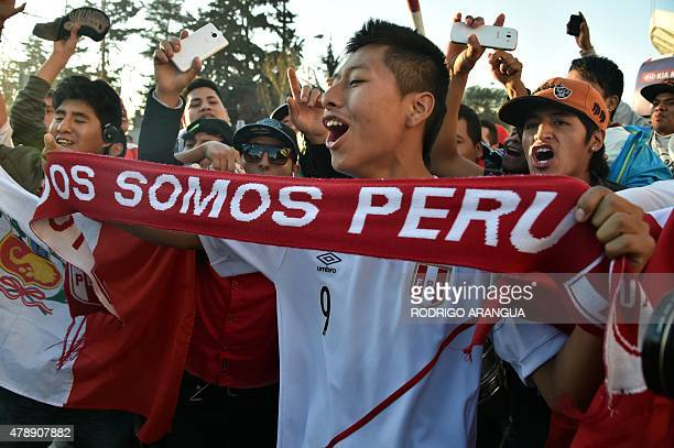 Peru's supporters wait for players as they arrive for a training session at the National Stadium in Santiago on June 28 during the Copa America...