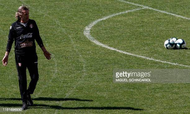 Peru's team coach Ricardo Gareca conducts during a training session at Pacaembu Stadium in Sao Paulo Brazil on June 24 2019 ahead of their Copa...