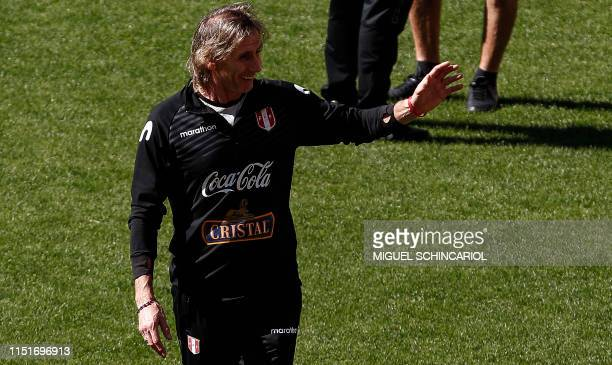 Peru's team coach Ricardo Gareca waves during a training session at Pacaembu Stadium in Sao Paulo Brazil on June 24 2019 ahead of their Copa America...