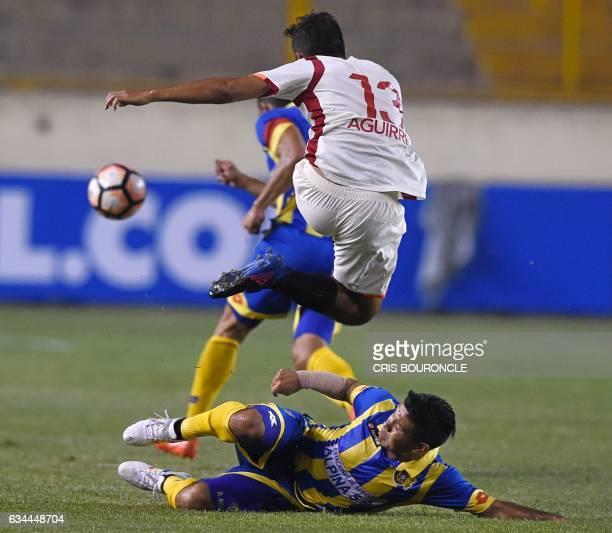 Perus Universitario player Joaquin Aguirre and Paraguays Deportivo Capiata player David Mendieta vie for the ball in the firstround Copa Libertadores...