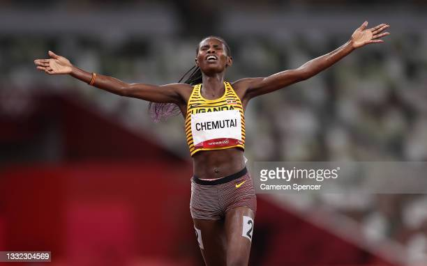 Peruth Chemutai of Team Uganda celebrates as she wins the gold medal in the Women's 3000m Steeplechase Final on day twelve of the Tokyo 2020 Olympic...