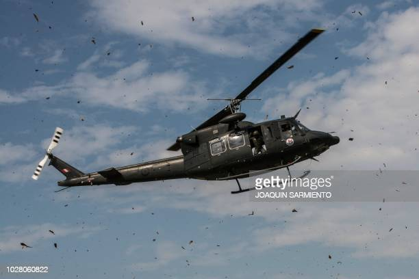 Peruvian Air Force helicopter takes part in an earthquake simulation exercise held by Air Force troops from Colombia, the Dominican Republic, Peru,...