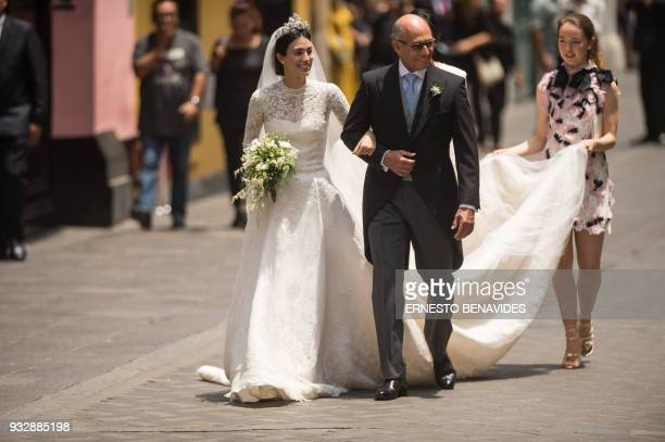 Peruvian Alessandra de Osma arrives next to her father Felipe de Osma to her wedding with Prince Christian of Hanover at the San Pedro church in Lima...
