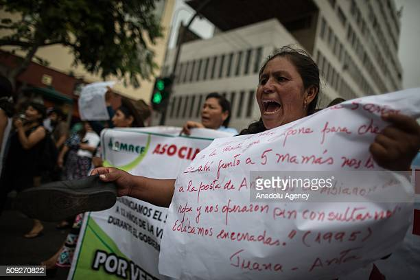 Peruvian andean women victims of forced sterilizations during the administration of Peru's former President Alberto Fujimori attend a protest in Lima...