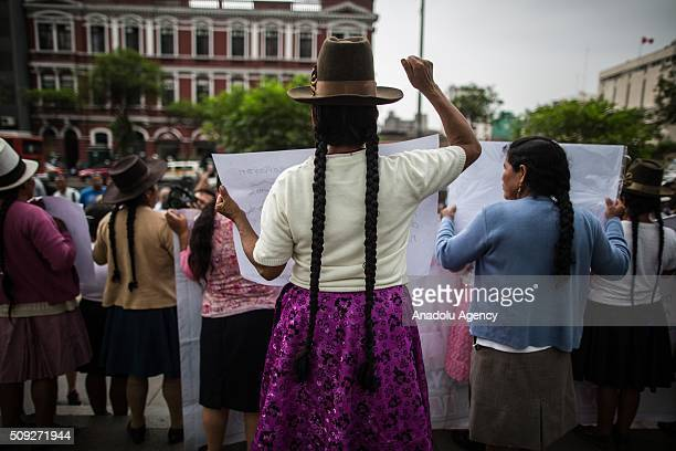 Peruvian andean women, victims of forced sterilizations during the administration of Peru's former President Alberto Fujimori, attend a protest in...