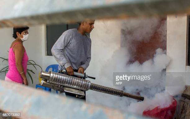 Peruvian Army soldiers participate in a massive fumigation program of 20000 homes per day against a dengue outbreak on May 11 2017 in Piura Peru...