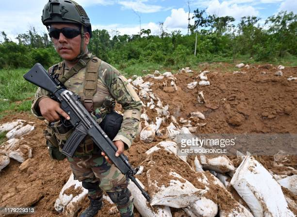 Peruvian Army soldiers take part in an operation to blow up a makeshift landing strip used by drug smugglers, in the northeastern Amazon jungle near...