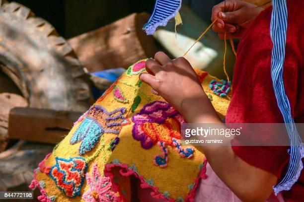 Peruvian artisan embroidering