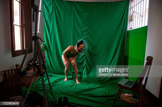 Peruvian artist Ana Chung performs during a live streaming at her house in Lima, on June 24 amid the new coronavirus pandemic. - With the decision of...