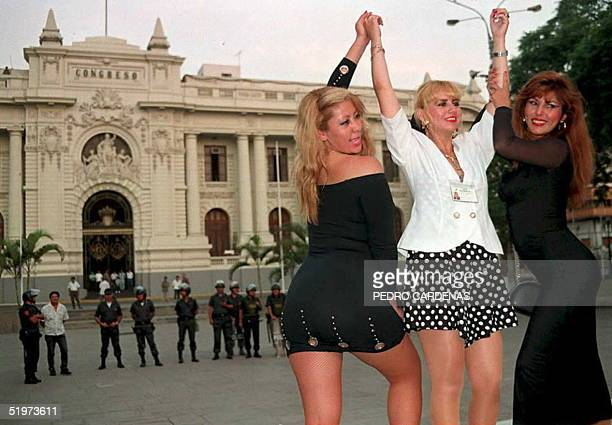Peruvian candidate to Parliament and cabaret dancer Susie Diaz is flanked by her fellow dancers Iris Loza and Rosy Carrasco in front of the Congress...