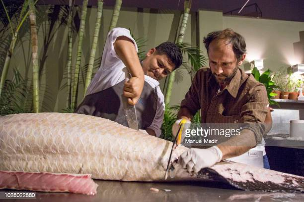 Peruvian cheff Pedro Miguel Schiaffino performs during an event to promote responsible fishing and encourage people to eat wild sustainable paiche...