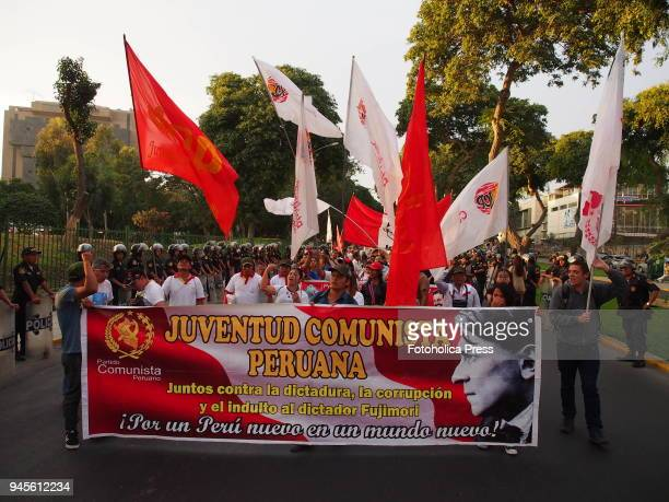 Peruvian Communist Party activists waving flags when thousands of Latin American left wing activists conducted an antiimperialist march against the...