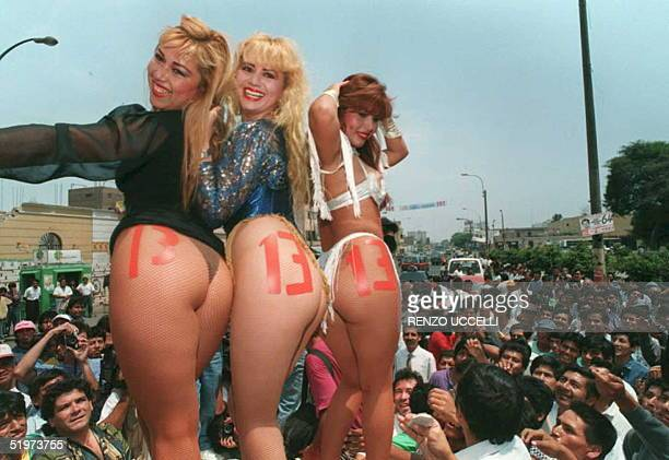 Peruvian dancer-actress Susy Diaz is flanked by two fellow workers Belgica Rodas and Iris Loza 05 April during an electoral campaign in downtown Lima...
