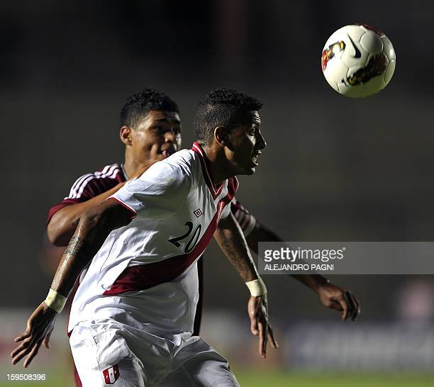 Peruvian defender Edwin Gomez vies for the ball with Venezuelan forward Josef Martinez during their South American U-20 Championship Group B football...