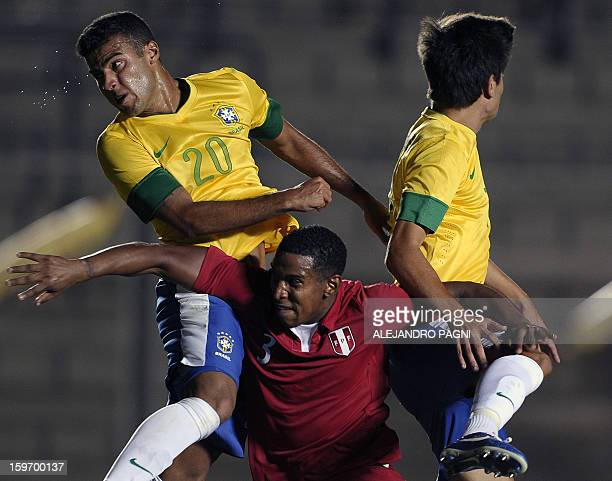 Peruvian defender Marcos Ortiz jumps for the ball with Brazilian midfielders Rafael Alcantara and Nico Mattheus during their South American U-20...