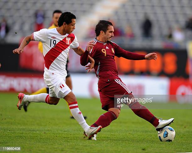 Peruvian defender Yoshimar Yotun vies with Venezuelan forward Giancarlo Maldonado during the thirdplace match of the 2011 Copa America football...