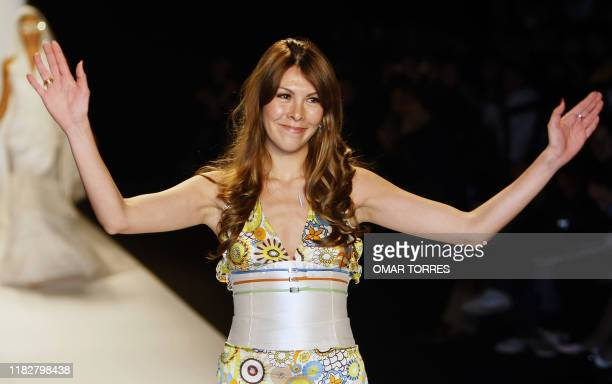 Peruvian designer Claudia Jimenez acknowledges the audience at the end of the presentation of her collection during the first day of Fashionweek in...