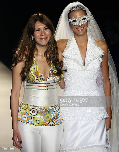 Peruvian designer Claudia Jimenez poses with one of her models at the end of the presentation of her collection during the first day of Fashionweek...