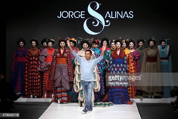 Peruvian designer Jorge Salinas greets the audience after his Handmade kimonos show as part of Peru Moda 2015 at Peruvian Army Headquarters 'El...