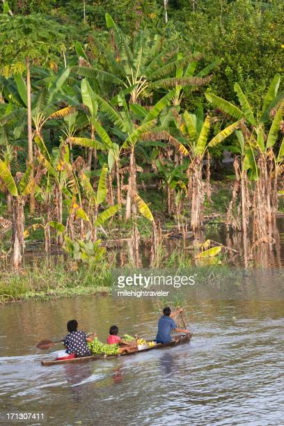 Peruvian family canoeing Amazon River